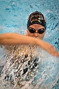 Water flies off her arm as Jenna Beeler '13 makes a turn during the Women's 200 yard Medley Relay at the Grinnell College Pioneer Invitational..BEN BREWER/Grinnell College