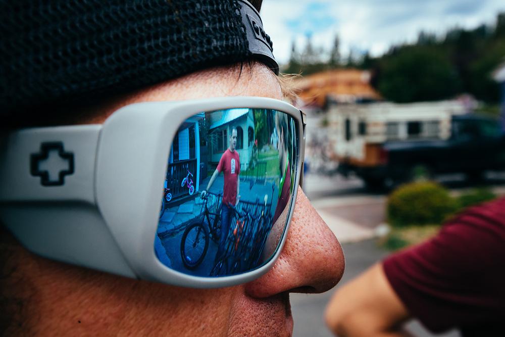 James Munly - Das Rad Haus bike shop owner reflected in Rex Flake's sunglasses.
