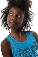 Young african american girl looking up pensive and smiling.