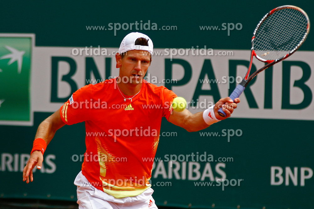 16/04/2012 Monte Carlo, Monaco. Jurgen Melzer (AUT) in action during the first round match between Lukasz Kubot (POL) and Jurgen Melzer (AUT)  // during Rolex Masters tennis tournament of ATP World Tour at Country Club, Monte Carlo, Monaco on 2012/04/16. EXPA Pictures © 2012, PhotoCredit: EXPA/ Mitchell Gunn