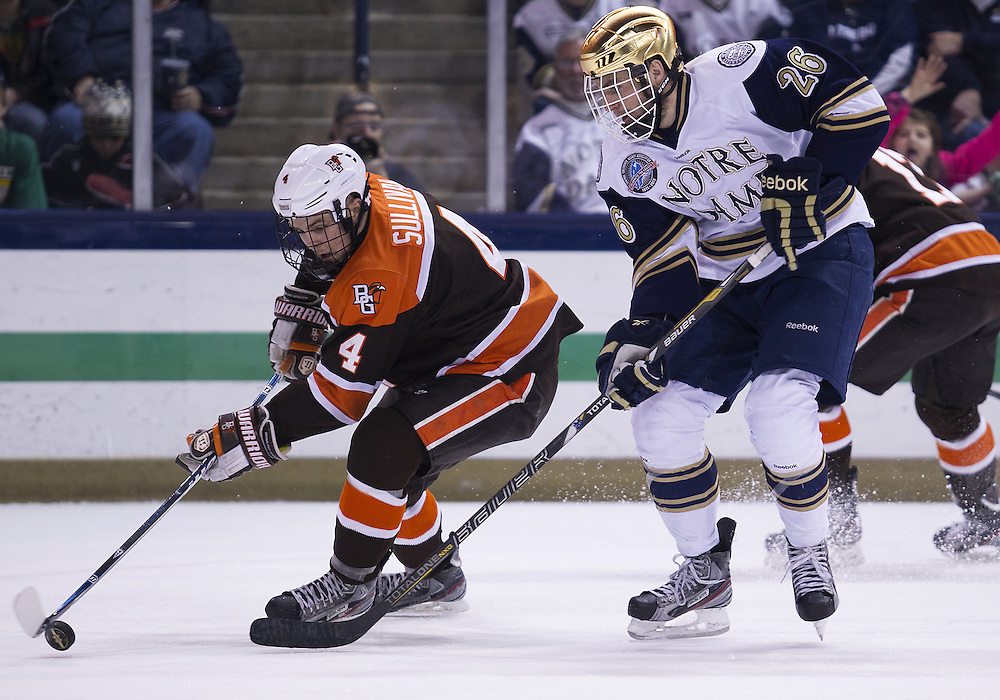 March 15, 2013:  Bowling Green defenseman Mike Sullivan (4) skates with the puck as Notre Dame center Steven Fogarty (26) back checks during NCAA Hockey game action between the Notre Dame Fighting Irish and the Bowling Green Falcons at Compton Family Ice Arena in South Bend, Indiana.  Notre Dame defeated Bowling Green 1-0 in overtime.
