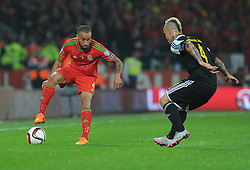 Jazz Richards of Wales (Swansea City) looks to attacks past Radja Nainggolan of Belgium (Roma) - Photo mandatory by-line: Alex James/JMP - Mobile: 07966 386802 - 12/06/2015 - SPORT - Football - Cardiff - Cardiff City Stadium - Wales v Belgium - Euro 2016 qualifier