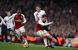 Tottenham Hotspur's Dele Alli battles for possession of the ball with Arsenal's Granit Xhaka