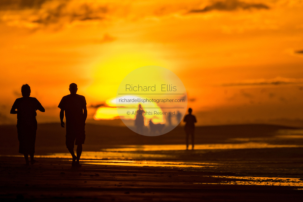 People gather along the beach to watch the sunrise on a cloudy morning June 5, 2017 in Folly Beach, South Carolina. Folly Beach is a quirky beach community outside Charleston known to locals as the Edge of America.