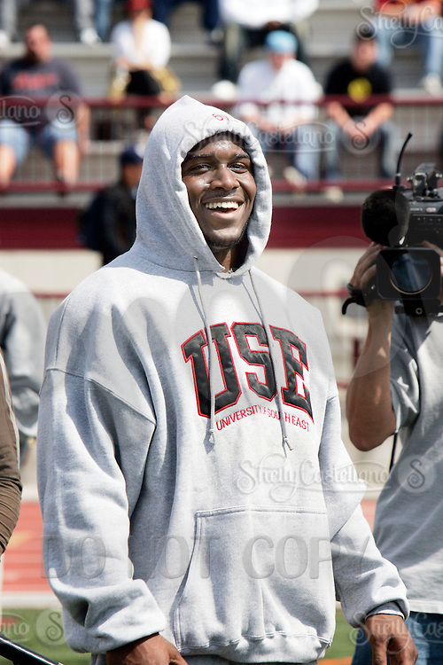 2 April 2006:  OH Reggie Bush had a laugh with friends at pro-day timing workout by pro football teams at NFL pro-timing day at USC college campus in Los Angeles, CA.  NCAA College Football  Heisman Trophy winner Reggie Bush of the USC Trojans. Now a NFL player for the New Orleans Saints.