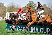 27 March 2010 : Richard Boucher and Class Deputy (#1) dual with Carl Rafter and Virginia Minstrel in the Camden Plate Maiden Hurdle race.