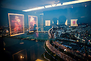 """Reflections of an exhibition with Asian Art Work on the top floor of the """"The 63 Building"""", officially the 63 City, at a skyscraper on Yeouido island, overlooking the Han River in Seoul, South Korea."""