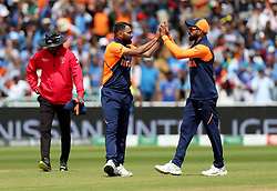 India's Mohammed Shami celebrates taking the wicket of England's Jonny Bairstow, caught by Rishabh Pant, with team-mate Virat Kohli (right) during the ICC Cricket World Cup group stage match at Edgbaston, Birmingham.