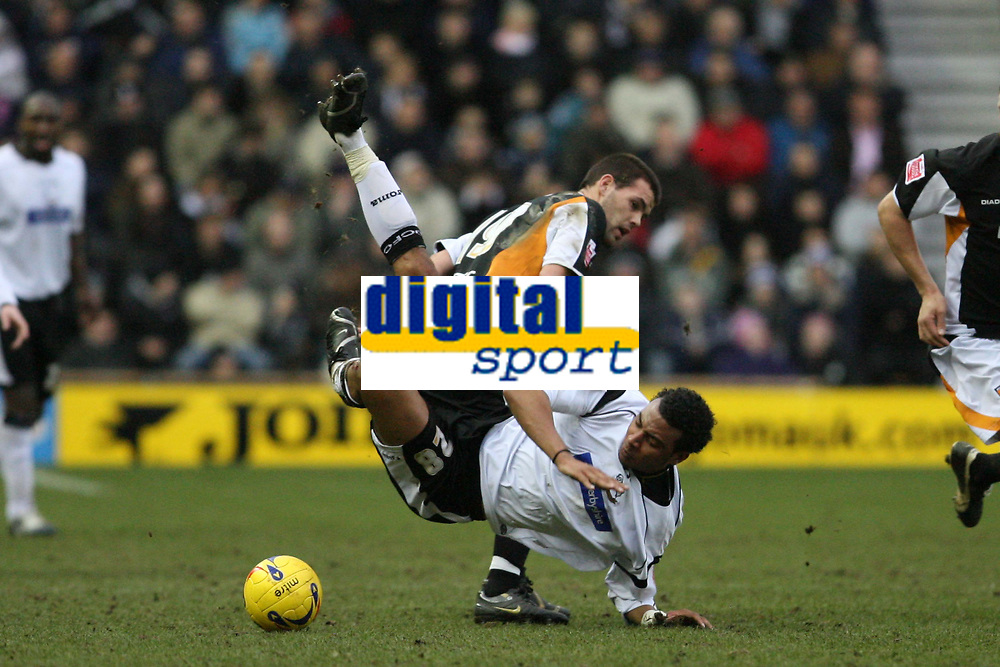 Photo: Pete Lorence.<br />Derby County v Hull City. Coca Cola Championship. 10/02/2007.<br />Jon Welsh sends Giles Barnes to the ground.