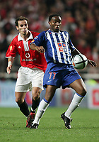 LISBOA 17 OCTOBER  2004: (L to R) PETIT #6 and MCCARTHY #77, in the, 6¼ leg of the Super Liga, season 2004/2005, match SL Benfica v  FC Porto, held in Luz stadium, 17/10/2004  19:45<br />(PHOTO BY: NUNO ALEGRIA / AFCD)