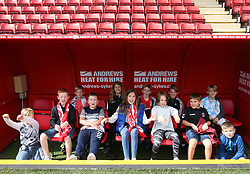 Charlton Athletic fans in the manager's dugout