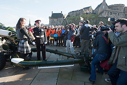 Miss Scotland Jennifer Reochs after firing of the One O'clock gun with Gunner Jamie Shannon..The Miss World participants visit Edinburgh Castle and will witness the firing of the One O'clock gun..MISS WORLD 2011 VISITS SCOTLAND..Pic © Michael Schofield.