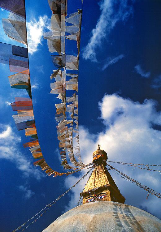 Prayer flags fill the sky at Bodnath Stupa, Kathmandu, Nepal.