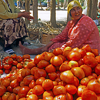 Uygur women sell tomatoes at an outdoor bazaar in Kashgar (Kashi), a city on the ancient Silk Road in Xinjiang, China.
