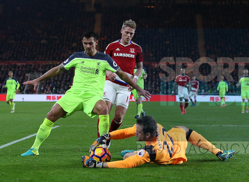 Simon Mignolet of Liverpool slides out to collect the ball as Dejan Lovren of Liverpool protects him  during the English Premier League match at the Riverside Stadium, Middlesbrough. Picture date: December 14th, 2016. Pic Simon Bellis/Sportimage