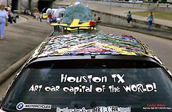 Stock photo of an art car sticker on a rear windshield
