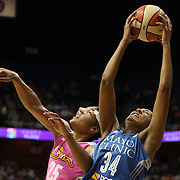 Damiris Dantas, (right), Minnesota Lynx, rebounds while challenged by Alyssa Thomas, Connecticut Sun, during the Connecticut Sun Vs Minnesota Lynx, WNBA regular season game at Mohegan Sun Arena, Uncasville, Connecticut, USA. 27th July 2014. Photo Tim Clayton