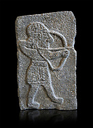 Hittite relief sculpted orthostat panel of an archer from the Palace of King Kapara, from Tell Halaf, ancient Guzana, Syria, iX cent BC, Louvre Museum. Cat No 11072 . Black background