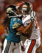 [PHOTO # 6 ]  <br /> <br /> 10 28 2007 - TAMPA - Garcia's pass bounces off of Bucs wide receiver Ike Hilliard (19) as he's hit by Jacksonville's Rashean Mathis (27) in the final minute of the fourth quarter. The Jaguars' Reggie Nelson intercepted the ball to end the game. The Bucs lost to the Jaguars 24-23.<br /> <br /> BRIAN CASSELLA | Times<br /> <br /> NFL FOOTBALL - Tampa Bay Buccaneers vs Jacksonville Jaguars at Raymond James Stadium on Sunday (10/28/07).
