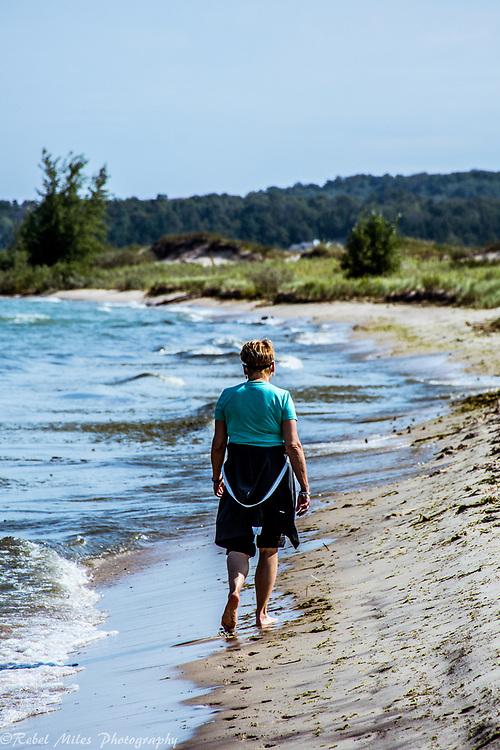 Walking The Beach At Leeland State Park On Lake Michigan