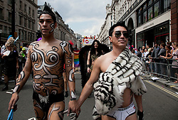 © Licensed to London News Pictures. LONDON, UK  02/07/11. Revellers enjoy London's Pride March. 21 floats and around a million people flocked to Central London for the festival which celebrates the diversity within the LBGT (lesbian, gay, bisexual and transgender) community.  Please see special instructions for usage rates. Photo credit should read Matt Cetti-Roberts/LNP