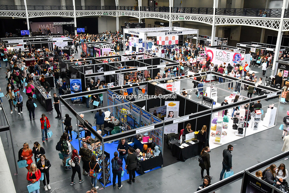 Exhibitor and make-up artists from around the world demo at IMATS on 18 May 2019,  London, UK.
