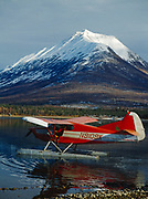 Howard Bowman's Stinson Voyager 108 with a PDX Conversion preparing to taxi on Hardenburg Bay of Lake Clark, Tanalian Mountain beyond, Lake Clark National Park and Preserve, Alaska.