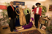 Vintage clothes shop dummies together as if at a fictional party in Hay-on-Wye, Wales, United Kingdom.