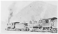 """Two RGS class 60 locomotives pulling freight.<br /> RGS  Vance Junction, CO  ca 1915<br /> In book """"Southern, The: A Narrow Gauge Odyssey"""" page 89<br /> See RD155-085 for enlargement."""