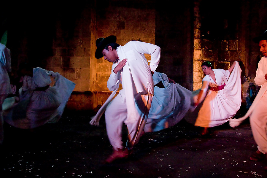 A dance troupe performs Jarabes Yalaltecos, from Villa Hidalgo Yalalag, region of the Sierra Juarez, at an evening Guelaguetza performance in the courtyard of the Church of Carmen Alto in Oaxaca City, Oaxaca, Mexico on July 16, 2008. The Guelaguetza is an annual folk dance festival in Oaxaca - dancers from different regions of the state gather in celebration in Oaxaca City and towns in the Central Valley to perform their regional dances wearing traditional costumes and throw regional specialties as gifts into the crowds.