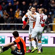 Galatasaray's Burak Yilmaz (C) and Wesley Sneijder (R) celebrate goal during their Turkish superleague soccer match Kayserispor between Galatasaray at Kadir Has Stadium in Kayseri Turkey on Sunday, 17 March 2013. Photo by TURKPIX