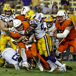 Sep 23, 2017; Baton Rouge, LA, USA; LSU Tigers linebacker Corey Thompson (23) hits Syracuse Orange quarterback Eric Dungey (2) during the fourth quarter of a game at Tiger Stadium. LSU defeated Syracuse 35-26. Mandatory Credit: Derick E. Hingle-USA TODAY Sports
