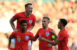 England's Marcus Rashford (bottom left) celebrates scoring his side's first goal of the game with team-mates Phil Jones, Jordan Henderson and Trent Alexander-Arnold during the International Friendly match at Elland Road, Leeds.