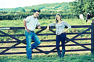 Couple standing by a five post gate