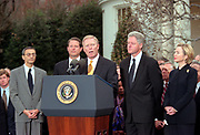 U.S President Bill Clinton listens to Minority Leader Dick Gephardt surrounded by Democratic leaders outside the White House following his impeachment December 19, 1998 in Washington, DC.  The US House of Representatives impeached Clinton on charges of perjury and obstruction of justice. Clinton rejected calls for his resignation and vowed to continue in office.
