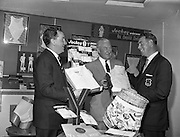 """10/10/1959<br /> 10/10/1959<br /> 10 October 1959<br /> Christy O'Connor """"Senior' (right), well known professional golfer selecting shirts at Dublin Shirt and Collar Co., Sycamore Street, Dublin. O'Connor is waring his 1957 Ryder Cup Jacket, in which competition he played an important part in securing the British team's win over the United States."""