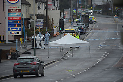 © Licensed to London News Pictures, 09/04/2018, Police and forensic officers at the scene of a shooting in Collier Row road in Havering where a male in his forties, believed to be carrying a firearm was shot and killed by armed police officers at around 4 am this morning; Photo credit: Steve Poston/LNP