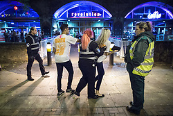 """© Licensed to London News Pictures . 16/11/2015 . Manchester , UK . A woman is ejected from the event . Annual student pub crawl """" Carnage """" at Manchester's Deansgate Locks nightclubs venue . The event sees students visit several clubs over the course of an evening . This year's theme is """" Animal Instinct - unleash your beast """" . Photo credit : Joel Goodman/LNP"""