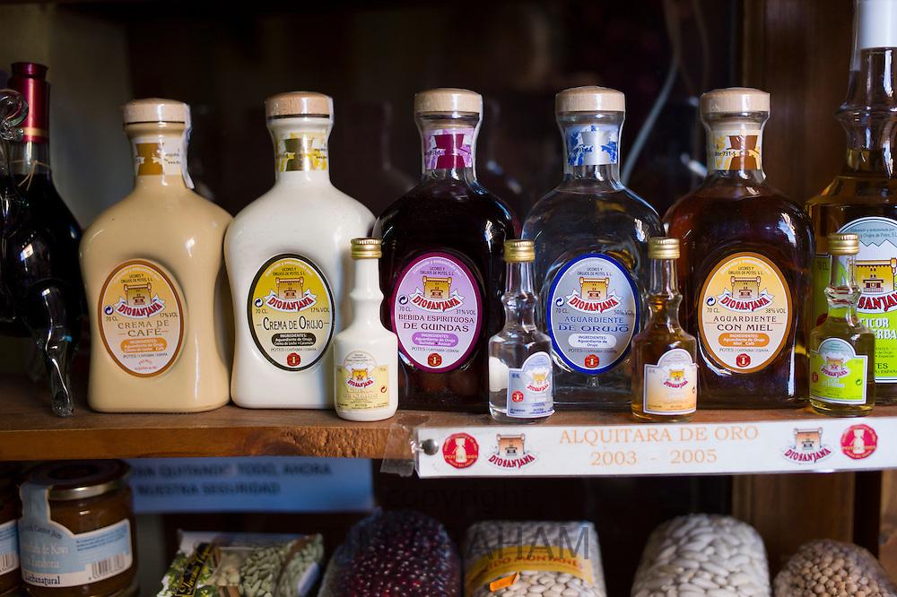 Crema de Orujo and Crema de Cafe local speciality flavoured liqueurs on sale in shop in Potes, Cantabria, Spain