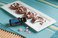 Peppermint oil with chocolate covered cookies.