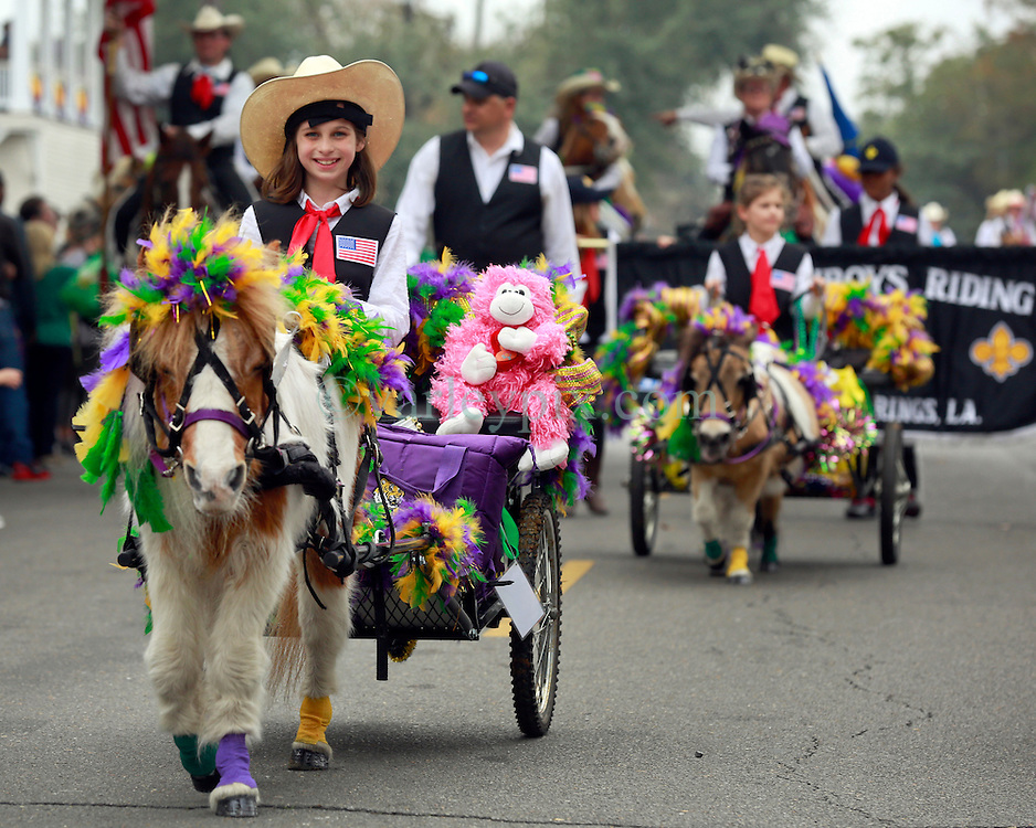15 Feb 2015. New Orleans, Louisiana.<br /> Mardi Gras. A young girl and her pony before the Krewe of Thoth rolls Uptown.<br /> Photo; Charlie Varley/varleypix.com