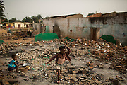 A girl walks through rubble of demolished Muslims' homes in the district of Miskine in the capital Bangui March 5, 2014.