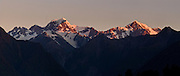 Sunset light strikes Mount Tasman and Aoraki/Mount Cook (left to right) on South Island, New Zealand. In 1990, UNESCO honored Te Wahipounamu - South West New Zealand as a World Heritage Area. Panorama stitched from 3 overlapping photos.