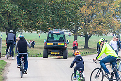 © Licensed to London News Pictures. 08/11/2020. London, UK. Police patrol Richmond Park as members of the public go out to exercise in a busy Richmond Park in South West London on the 4th day of the new lockdown. Cyclists, walkers, and families descended on the park as traffic jams built up at car parks while Police patrolled the park in 4x4 vehicles. Prime Minister Boris Johnson announced new Covid-19 lockdown restrictions for England from last Thursday with pubs, restaurants, non-essential shops and gyms to close as the coronavirus infection rate continues to rise. Photo credit: Alex Lentati/LNP