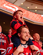 A father and son watch the Washington Capitals defeat the Carolina Hurricanes 2-0 at Capital One Arena on January 13, 2020.