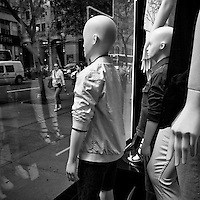 Mannequins quietly observing life on Fifth Avenue