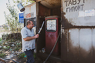 A man returns the nozzle to its position after refueling a vehicle at an old gas station in Goris, Armenia<br /> <br /> (September 21, 2016)