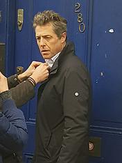 Hugh Grant is seen filming at the blue door - 26 Feb 2018