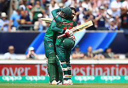 Bangladesh's Tamim Iqbal celebrates reaching his century with Mushfiqur Rahim during the ICC Champions Trophy, Group A match at The Oval, London.