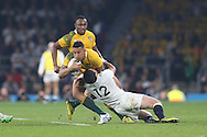 Israel Folau of Australia is tackled by Brad Barritt of England. Rugby World Cup 2015 pool A match, England v Australia at Twickenham Stadium in London, England  on Saturday 3rd October 2015.<br /> pic by  John Patrick Fletcher, Andrew Orchard sports photography.